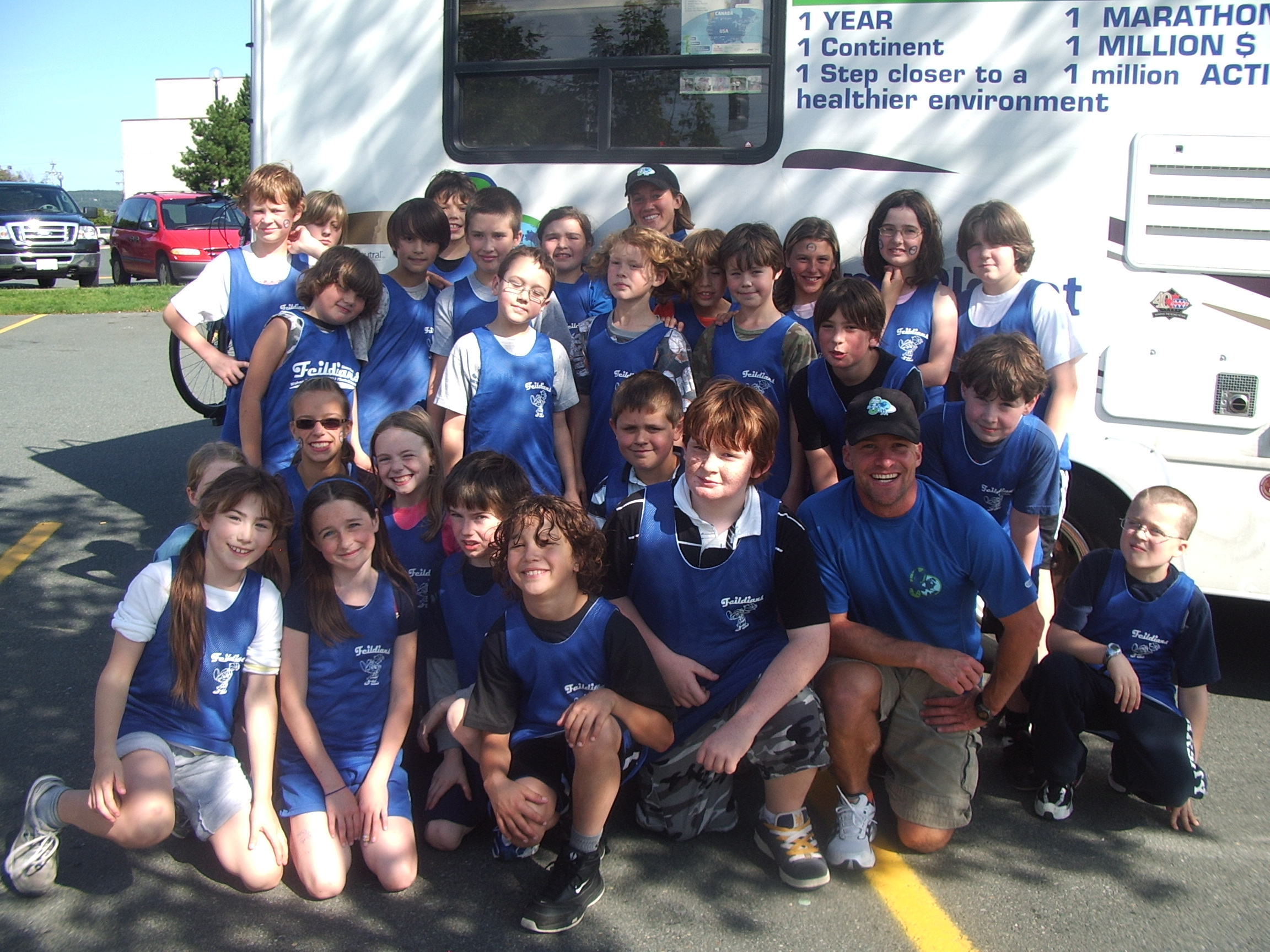 Steph & Matt hang with the Bishop Field School runners before running to the school for their presentation!